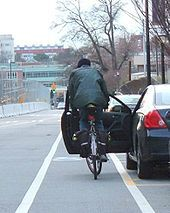 """TIL in the Netherlands, drivers taking their license exam are required to open the door with their right hand, thereby turning their torso and allowing them to see any oncoming cyclists, hence the term """"Dutch reach"""" Cycle Stand, Netherlands, Bicycle, Cyclists, Turning, Dutch, Transportation, Internet, Car"""