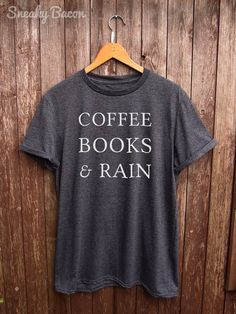 Welcome to the Sneaky Bacon Clothing Shop!   About this product:  This Coffee Books And Rain shirt is made of premium quality ring spun cotton for a lovely quality soft feel and casual fit. All our shirts are DTG (direct to garment) printed to ensure the durability of the print and give a long lasting and vibrant finish to all our designs. ---------------------------------------------------------------------------------------------------------  Sizing Guide (Unisex and conversion to womens…