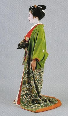Scan C2.  Kitsuke. scan from book '300 years of Japanese Women's appearance, kimono, kanzashi, etc.  The outer kimono, an uchikake, appears to date from the first half of the 19th century (as does the obi).