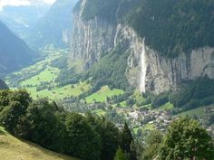 Looking down on Lauterbrunnen, Switzerland while going up to the Jungfraujoch via Wengen. Those cliffs are 2,500 feet tall!