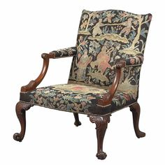 George II Mahogany Library Armchair Circa 1755 The serpentine crest rail above a padded backrest and seat, raised on acanthus carved cabriole legs ending in scrolling toes.