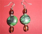 Brown glass beads and green with black marble design glass beads. Silver spacers and fish hook earring. Price: $6.00