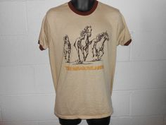 Check out this item in my Etsy shop https://www.etsy.com/listing/255107014/vintage-80s-the-meadowlands-nj-horse