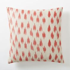 Metallic Ikat Dot Pillow Cover - Poppy  l  Handwoven with subtle metallic threads, our Metallic Ikat Dot Pillow Cover has a beautiful, slightly marled look. The pattern is a true ikat, meaning that it is hand painted onto the yarns during the weaving process. Each pillow cover is made with a lightly textured silk cotton blend
