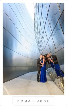 Walt Disney Concert Hall Engagement Photos.   We love the gorgeous architecture of the Walt Disney Concert Hall.  The reflection in this pathway between buildings is one of our favorite Engagement Session Photos.