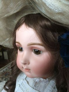Breathtaking antique brunette Triste Jumeau with hand blown brown paperweight eyes.