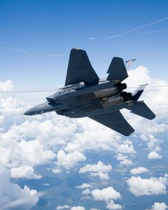Underside of Boeing F-15E1, the F-15SE Silent Eagle demonstrator aircraft, displaying an open weapons bay housing an AIM-120 AMRAAM. Boeing photo