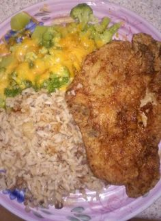Fried pork chop, broccoli cheese and dirty rice