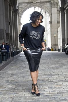 How to wear the vinyl trend-Minimize the severity of a vinyl skirt by pairing it with a casual item like a sweatshirt