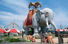 Lucy the Elephant - Margate City, NJ. Victorian speculator James V. Lafferty, who hit upon the idea of driving up interest in beachfront property he owned by constructing 'Lucy,' a building shaped like an elephant. Though 'zoomorphic architecture' failed to take off, Lucy became a popular tourist attraction, her belly serving variously as a restaurant, summer home and speakeasy.