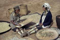 Burma - Karenni State | Padaung women wear about fifty pounds of brass collars and leg coils. | ©W Robert Moore