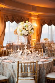 Classic Traditional & Delightful! #Centerpiece   On SMP - http://www.StyleMePretty.com/little-black-book-blog/2013/08/20/oheka-castle-wedding-from-robert-kathleen-photographers/ Robert & Kathleen Photographers