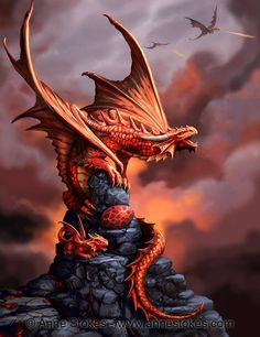 Draco Ignis (commonly known as the fire dragon) has glands in its mouth that spit out a mixture of chemicals which ignite on contact with air. It is aggressive in nature, territorial and extremely dangerous. The adult, young and egg are seen here together on lava rocks. © Anne Stokes. Age of Dragons.