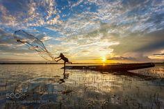 Fishermen in Thailand by PramotePolyamate