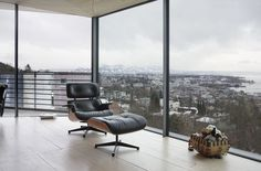 Spectacular city view is even nicer when viewed from an #Eames lounge chair and ottoman by @vitra