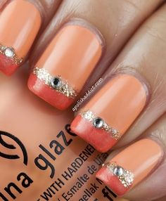 Orange french mani bordered with gold glitter!