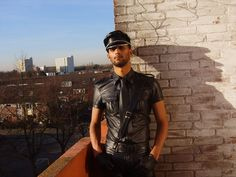https://flic.kr/p/4tAzuT   LeatherRomeo   Amsterdam Leathercop (or is it just a PoliceDog?) looking right at you from his balcony while enjoying the first rays of spring. A young and warm feeling of leather pride...