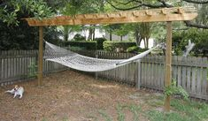 DIY pergola hammock stand -  All of the Planting Going on in our Yard - What's Working & What's Not - Charleston Crafted
