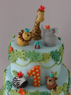 I have just joined this wonderful site and thought that the first cake I would upload should be this fun cake I made just over a year ago. I really enjoyed modelling all the little animals :-) Jungle Safari Cake, Jungle Theme Cakes, Safari Cakes, Safari Party, Pretty Cakes, Beautiful Cakes, Amazing Cakes, Buttercream Fondant, Fondant Cakes