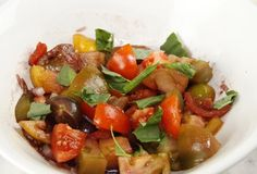 Heirloom Tomato Salad is drizzled with our delicious Balsamic Red Wine Reduction