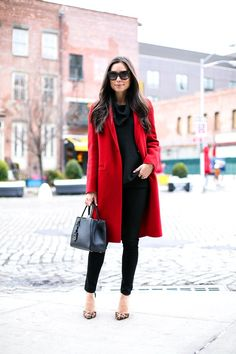 Kat Tanita of With Love From Kat wears a Vince red coat, Schutz leopard pumps, Michael Kors sweater, 7 For All Mankind jeans, and Fendi 2 jours bag in NYC.