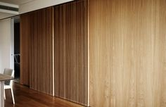 How clever . Sliding timber screens of solid and perforated slats open up spaces or conceal the kitchen from the living area in this small apartment by Sydney-based Koichi Takada Archit Apartment Interior Design, Kitchen Interior, Architects Sydney, Timber Screens, Hidden Kitchen, Wall Decor Design, Wood Slats, Wood Doors, Minimalist Kitchen