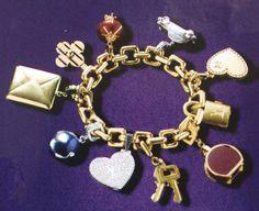 A gold and gem set charm bracelet by Louis Vuitton.