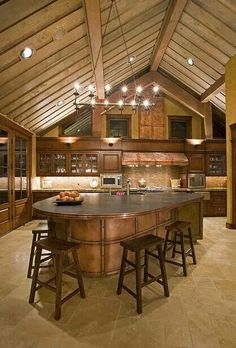 Gorgeous!  Love the exposed beams, warm wood, and tons of counter space!
