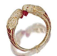 GOLD, RUBY AND DIAMOND 'PARROT' BANGLE-BRACELET - Sotheby's