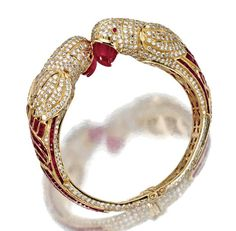 GOLD, RUBY AND DIAMOND 'PARROT' BANGLE-BRACELET - Sotheby's