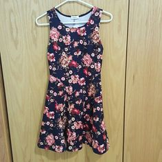 """Floral Dress NWOT red black pink Silky Material. Perfect condition. I'm 5'2"""" and it goes down to my knee Dresses Midi"""