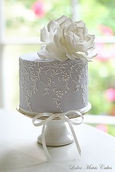 Grey wedding cake with sugar flower and vine detail