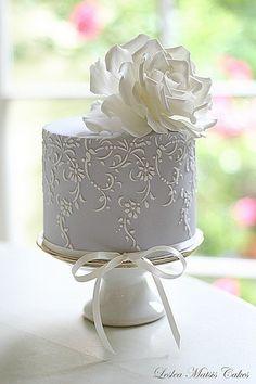 Grey wedding cake with sugar flower and vine detail