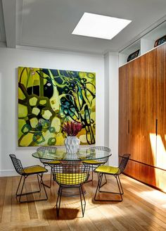 """Small kitchen and dining in Upper East Side, NY (The painting is """"Nessun Dorma"""" by Janaina Tschape.)"""