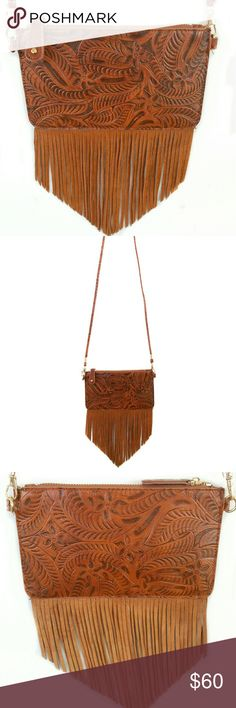 """Free People Small Crossbody Fringe Handbag Free People Crossbody Fringe Leather Handbag, convertible to a clutch (has removable straps), with zipper closure, suede leather fringe, black with white arrow print lining.  48"""" strap drop, 5"""" height, 12"""" height including fringe, 8 1/2"""" length.  Very small - perfect for your money, lip gloss, and id for a night out!  In like new condition. Free People Bags Crossbody Bags"""
