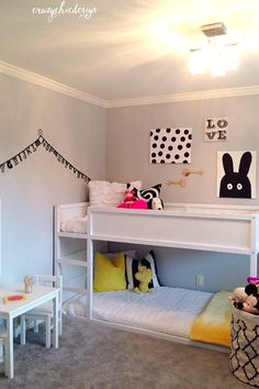 Create a shared space for a boy and girl by using black and white bedding as your neutral background.  Add brightly colored toss pillows to personalize each bed.  Large canvas totes work perfectly for toy storage. Available at HomeGoods. Sponsored Pin.