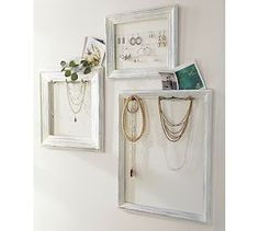 DIY:  Jewelry Display Frames - Pottery Barn Knockoff - using old frames, cup hooks, paint & cording, she turned unused frames into something she could display & organize her jewelry.