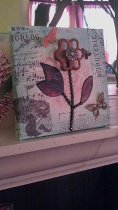 Mixed media art--flower using an old faucet handle.
