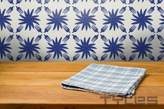 Tyles were originally made for a kitchen backsplash. Ideal for renters, or homeowners who want a change without commitment. Temporary tile. Knife Floral pattern. Tyles is a 2015 Martha Stewart American Made finalist.
