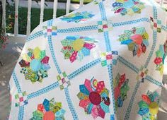 Dresden quilt with cheerful colors and nine patch sashing from: Hyacinth Quilt Designs: Dresden Plate quilt finished!