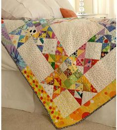 Polka-Dot Quilt  Combine vibrant polka dot prints to make a rainbow throw. This project is great for using up fabric scraps.                                          Get instructions for the polka-dot quilt.