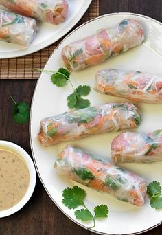Vietnamese rice paper rolls with creamy peanut dipping sauce.