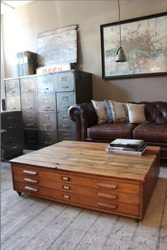 Industrial decor; that storage cabinet for drafting drawings is so cool as a coffee table!
