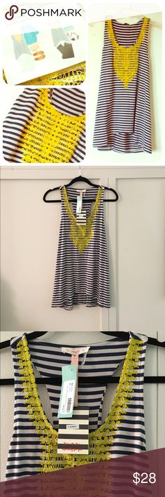 EMBROIDERED RACERBACK TANK Navy and white striped tank with yellow embroidery around neck and front. Racerback. Flares out at bottom. Rayon/polyester/spandex blend. Length is approximately 28 inches. Bust is approximately 30 inches. Le Sample Tops Tank Tops