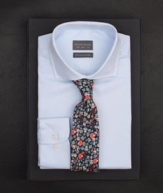 Simple yet creative. This is our Dark orange floral tie over the Wedgwood cutaway shirt.  www.Grandfrank.com