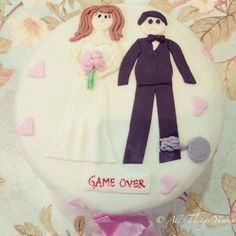 "Bachelorette Cakes - A Chocolate Truffle Bachelorette Cake with Fondant Couple and ""Game Over"" Message 