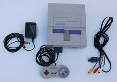 Check out this item in my Etsy shop https://www.etsy.com/listing/265845240/vintage-super-nintendo-console-snes-two
