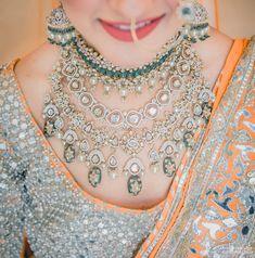 Beautiful polki and kundan emerald layered bridal necklace with peach and gold lehenga! | WedMeGood| Meher & Gursimran (Delhi) | #wedmegood #indianweddings #bridalnecklace #bridaljewellery #kundanset #polkiset #bridalset