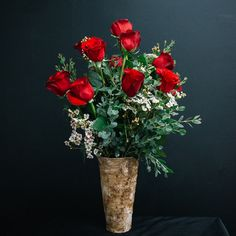 A modern take on the classic dozen roses, this arrangement is the perfect way to show someone you care. Large and beautiful, these dozen roses are accompanied by variegated pit, lemon leaf and wax flower, enhancing the roses and showing off their true beauty.