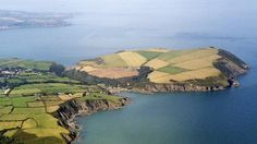 Strumble Head to Cardigan Abandon the car - this is Pembrokeshire's walking country. This is the most rugged and remote stretch of the Pembrokeshire Coast, from the peak of Garn Fawr near Strumble Head to the cliffs of Pen yr Afr in the north. Pen Anglas and Dinas Island guard the entrance to Fishguard Harbour, and Castell Farmhouse is a holiday cottage with a view few can equal.